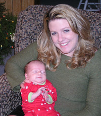 Becca with her daughter, Abby, a healthy, breastfed newborn, at Christmas 2005.